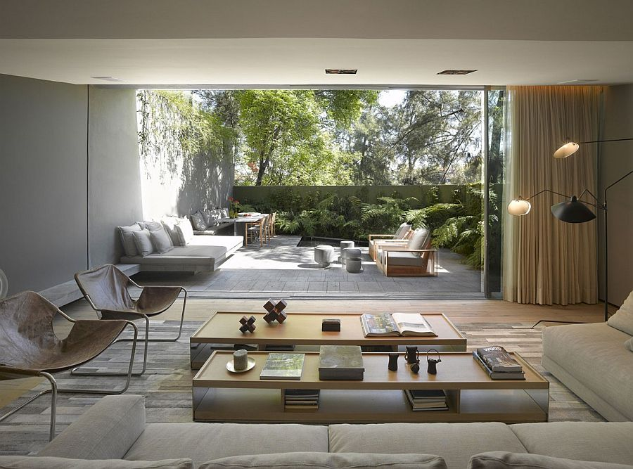 large-glass-wall-overlooking-outdoor-oasis
