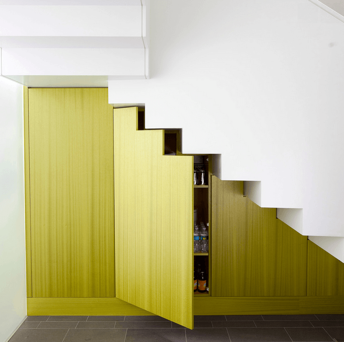 lime-green-doors-under-white-stairs-1